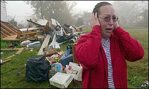 Distraught woman cries in front of her destroyed home in Carbon Hill, Alabama