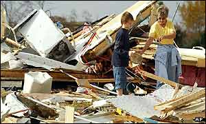 Residents inspect the remains of their neighbours' home, in Clarksville, Tennessee