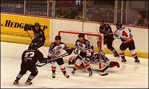 Manchester Storm (in black) on their way to victory in the 1999 Benson & Hedges Cup final