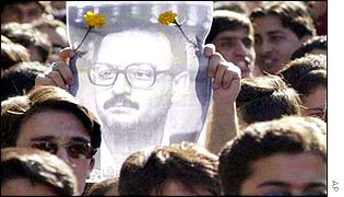Iranian students hold up a picture of condemned lecturer Hashem Aghajari