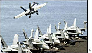 An aircraft takes off from USS Abraham Lincoln