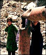 Children near ruins in Kabul