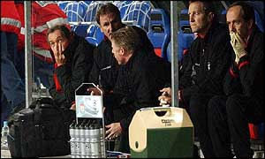 Gerard Houllier (left) suffers with his team