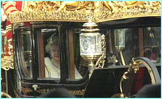 The Queen and Prince Philip travel to the Houses of Parliament in a horse-drawn carriage