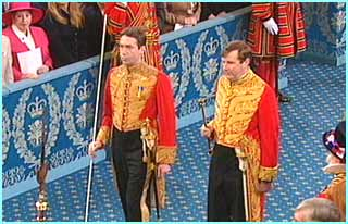 Royal servants enter the House of Lords before the Queen