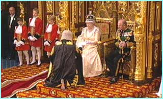 The Lord Chancellor hands the Queen her speech, which is written on goatskin
