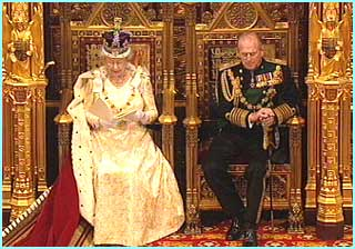 The Queen reads her speech while Prince Philip listens with everyone else