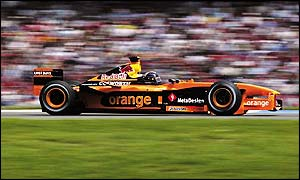 Heinz-Harald Frentzen, who is claiming money from the team, drives his Arrows past the crowd at the German GP