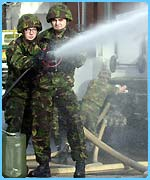 Soldiers with hose