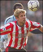 James Beattie wins a header against Manchester City