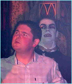 Darren Shan looks a bit worried to have a vampire standing behind him - mind your neck Darren!