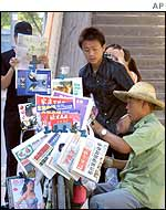 Young people at a newspaper stand