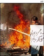 Kansi's supporters burn a tyre during a protest in Quetta