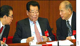 Parliament Chairman Li Peng (L) chats with top adviser Li Ruihuan (C) and politburo member Wei  Jianxing