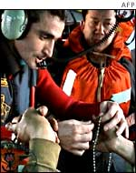 Crew members from the Prestige tanker on board a rescue helicopter