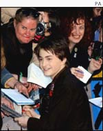 Daniel Radcliffe signs autographs at the premiere