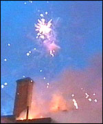 Fireworks explode from the building