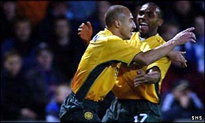 Henrik Larsson celebrates his goal with Didier Agathe