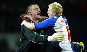 Rab Douglas and Neil Lennon celebrate the win