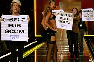 Supermodel Gisele Buchchen surrounded by fur protesters
