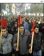 Demonstrators at a march organised by the Greek Communist Party in Thessaloniki against UN proposals for a reunification deal over Cyprus