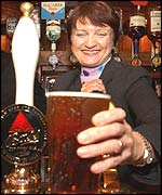 Tessa Jowell serving at the Red Lion bar