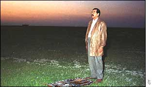 Saddam Hussein prepares to pray
