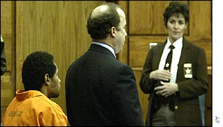 Muhammad (l) with his lawyer at an earlier court appearance