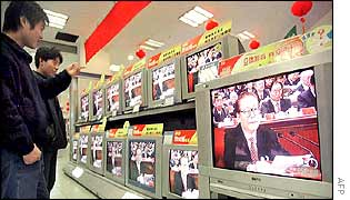 Jiang Zemin appears on television screens in a shop