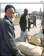 Old men collect aid parcels in Kabul