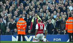 Thierry Henry celebrates in front of Spurs fans