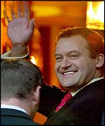 Paul Burrell waves to crowds