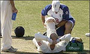 John Crawley receives treatment from the England physio