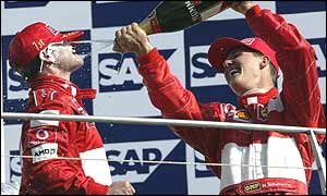 Rubens Barrichello and Michael Schumacher after the controversial finish to the US Grand Prix