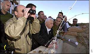 Ariel Sharon (centre) with military officials overlooking Hebron