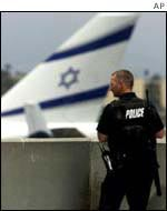 Policeman stands in front of El Al airplane
