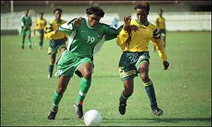 Mercy Akide (left) in action for Nigeria