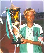 Florence Omagbemi holding the African Women's Championship trophy