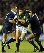 Gregor Townsend and Budge Poutney in action for Scotland