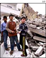 Palestinian children in the rubble of house