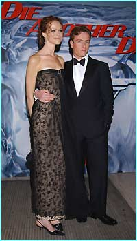 Toby Stephens, who plays Gustav Graves, arrives with his wife. He doesn't look too villanous to us...