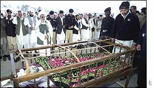 Mourners offer prayers at the funeral