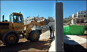 Bulldozer working on rebuilding of Hebron