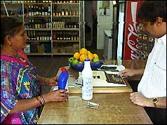 Ugandan Asian shopkeeper and customer
