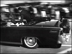 A secret serviceman jumps into Kennedy's car seconds after he was shot