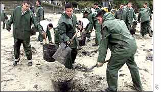 Clean up operation on beach in north west spain