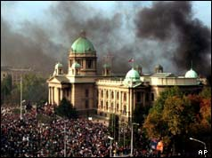 Smoke rises from the Yugoslav federal parliament, 05/10/00