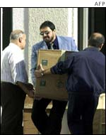 UN employees and arms inspectors deliver equipment