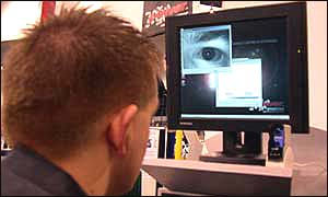 A visitor to the trade fair experiments with iris recognition technology