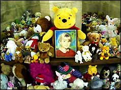 Cuddly toys surround a picture of murdered schoolgirl Sarah Payne at Guildford Cathedral